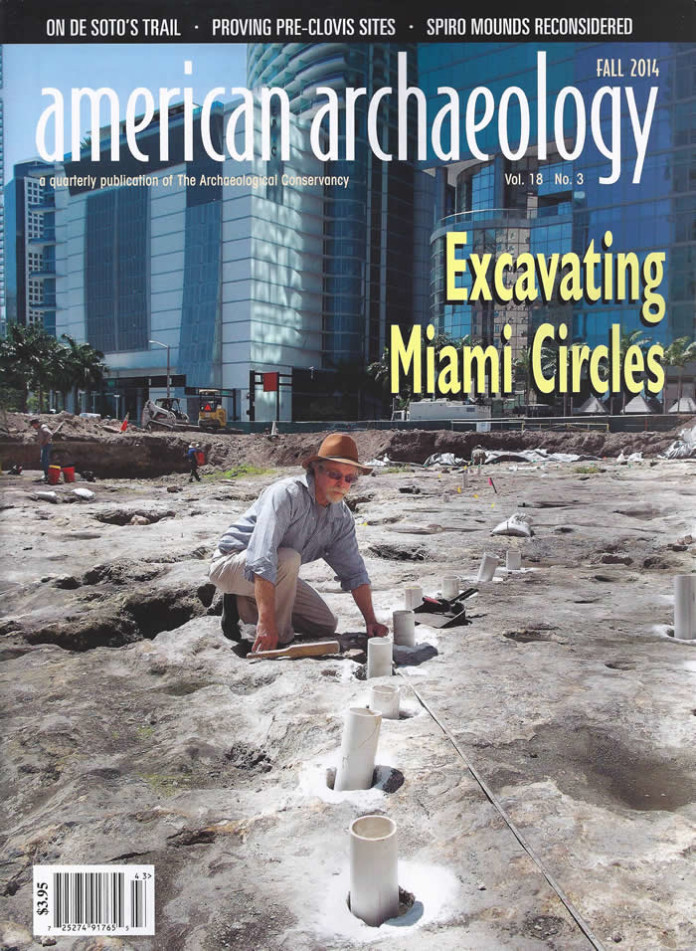 Archaeologist Robert Carr sets PVC pipes into postholes at the Miami Midden 1 site. Carr and his colleagues use the pipes, which they ring with baseball chalk, to emphasize the cite's circular and linear features for photographic documentation.