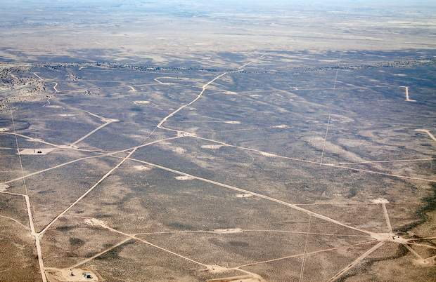 Mary Shinn/The Durango Herald A spiderweb of roads connects mostly natural-gas wells in the San Juan Basin south of Farmington. Advocates argue better planning could prevent hodgepodge development in southern areas of the basin where gas and oil companies are starting to use hydraulic fracturing to extract oil.
