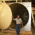 Conservator Peter Fix in front of a custom freeze-dryer used to preserve timbers at Texas A&M Conservation. Courtesy of the Bullock Museum.