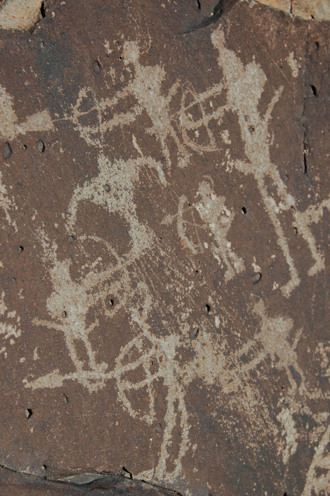 Petroglyph from the La Cieneguilla Battle Panel. Photo Courtesy of John Pitts, Serenepix@comcast.net