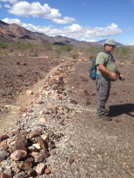BLM Archaeologist George Kline by one of the trenches