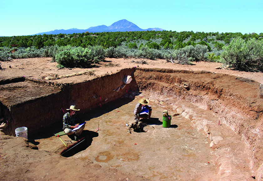 Archaeologists Steve Copeland and Caitlin Sommer document features on the floor of the great kiva.