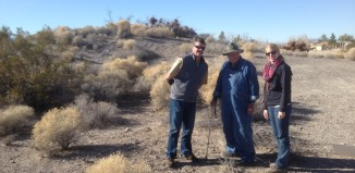 The mound in the background and Western Regional Director Cory Wilkins on the left, avocational archaeologists Don Hendricks in the middle, and Western Field Representative Deanna Commons on the right.