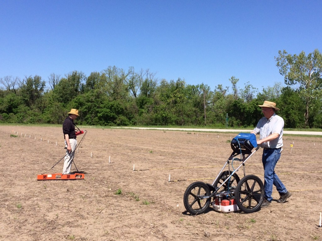 Jami Lockhart (left) and Tim Mulvihill (right) with the Arkansas Archaeological Survey using a zig round penetrating radar and conductivity meter.