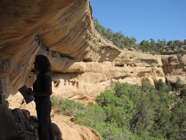 A VEP researcher examines a cliff dwelling at Mesa Verde National Park. Credit: Tim Kohler