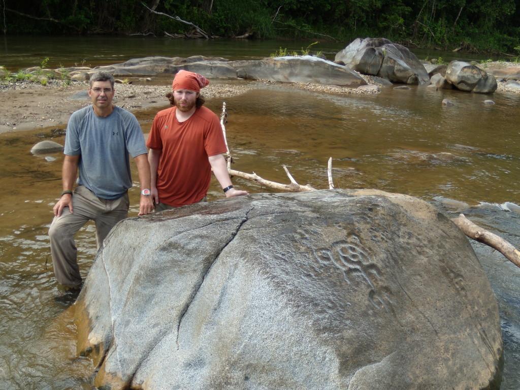 Archaeologist Chris Begley and Eli Crane visit petroglyphs on the Rio Platano in eastern Honduras. Photo Courtesy Chris Begley