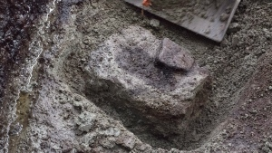 A section of soil where the impressions of human footprints buried at a shoreline archaeological site were discovered by researchers on Calvert Island, B.C. (Joanne McSporran / THE CANADIAN PRESS)