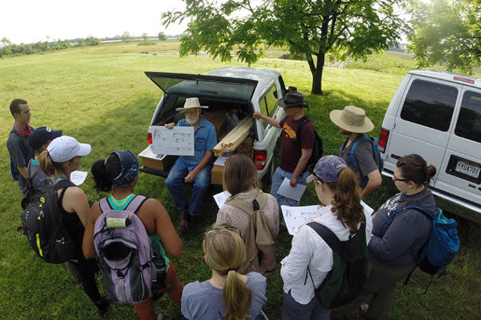 At the Carson Mounds Archaeological Field School near Clarksdale, Mississippi, Tulane University students listen to instructions from John Connaway, archaeologist with the Mississippi Department of Archives and History (seated). (Photos by Jayur Mehta/ Tulane University)
