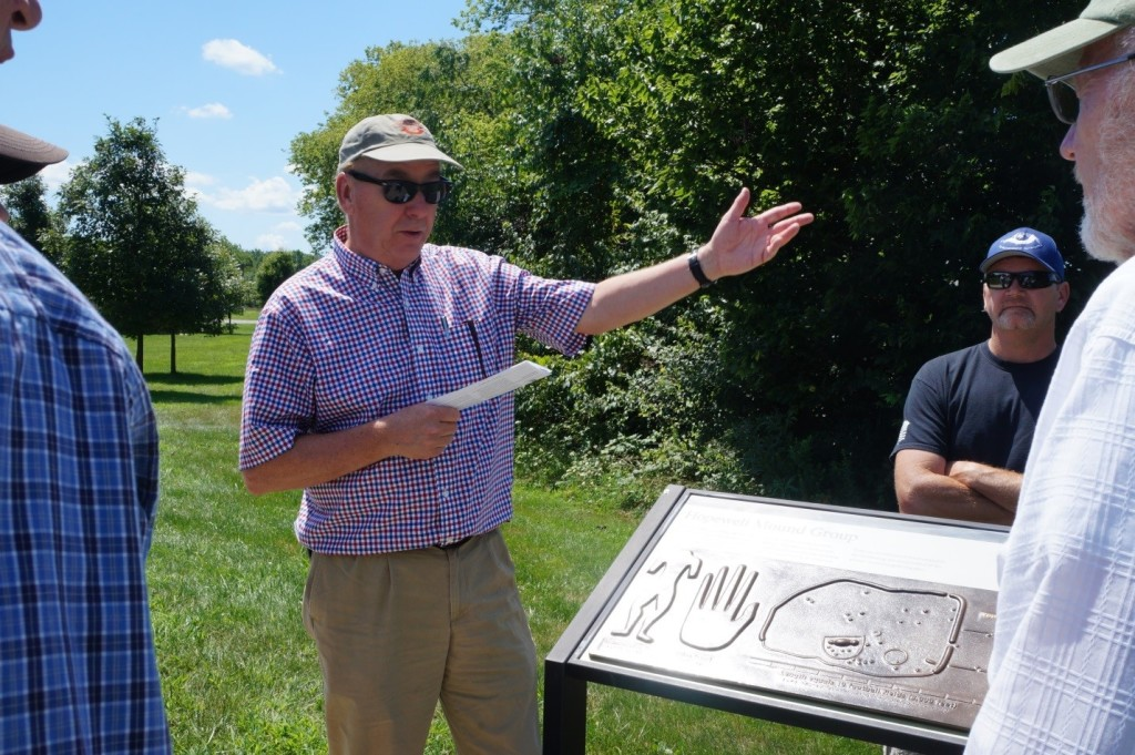 TAC CEO Mark Michel recounts the saga of The Hopewell site's preservation in front on an NPS interpretive sign at the site. Photo Bliss Bruen/The Archaeological Conservancy.