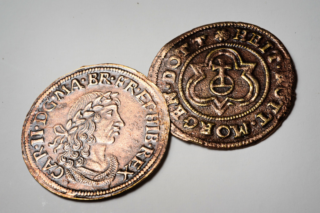 Archaeologists found these 17th-century counting tokens. Credit: Patrick Hall