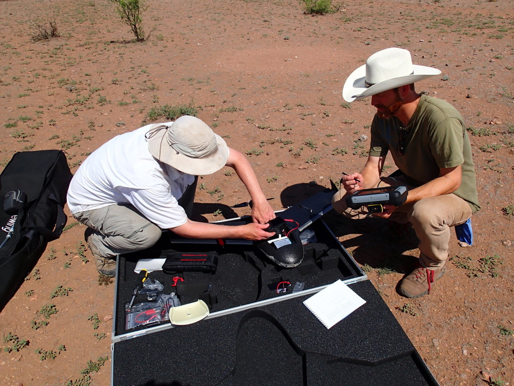 Scott Ure (left) and Mike Searcy from Brigham Young University prepare a drone for flight. Credit: Todd Pitezel