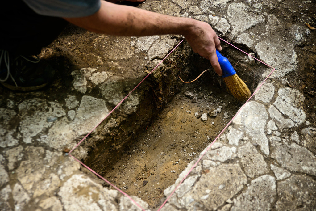 A researcher excavates the tabby floor at the Miller site. Credit: Patrick Hall