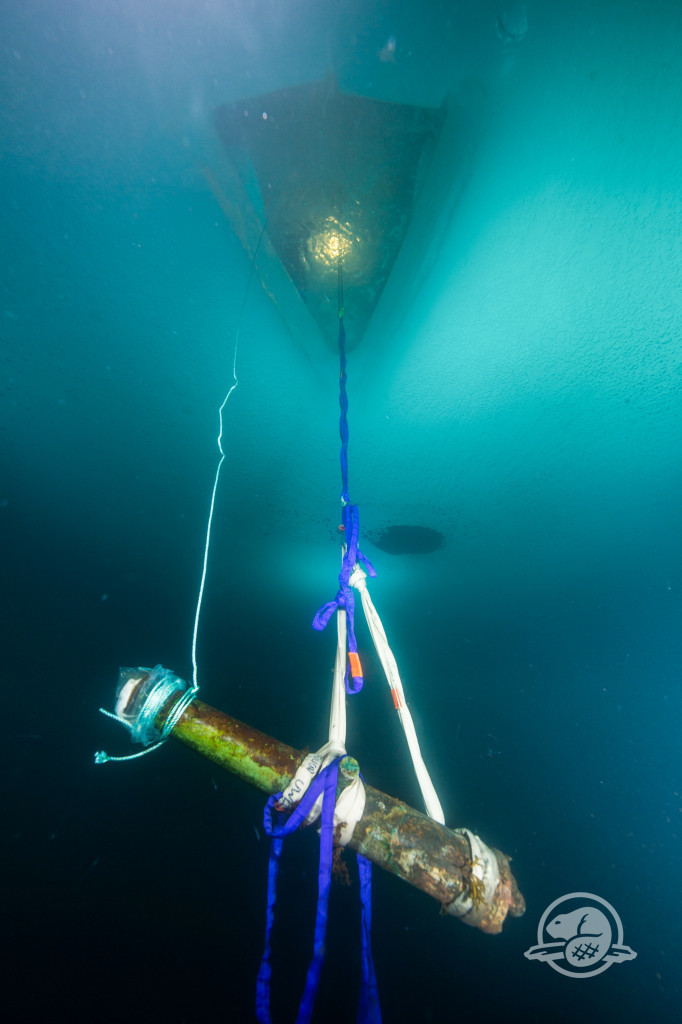 A cannon from Erebus is hoisted to the surface through an ice hole that can be seen near the top of the photo. Credit Parks Canada