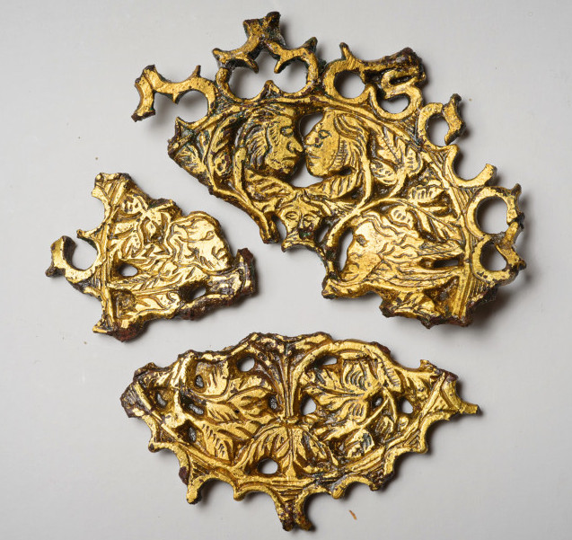 A European gold-plated brass cover for a wheel lock pistol depicting Adam and Eve. Credit: Patrick hall