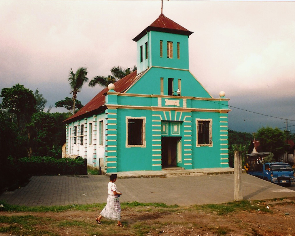 A woman walks by one of Chocola's churches. Kaplan spent a considerable amount of time trying to get the town's residents to support his project. Credit: Michael Bawaya