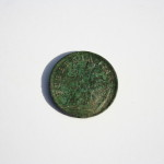 A 1723 Irish copper halfpenny that was also discovered in the cellar. Credit: Neill De Paoli