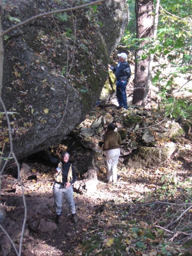 Soil scientists explore the Jeffrey Rock Shelter.