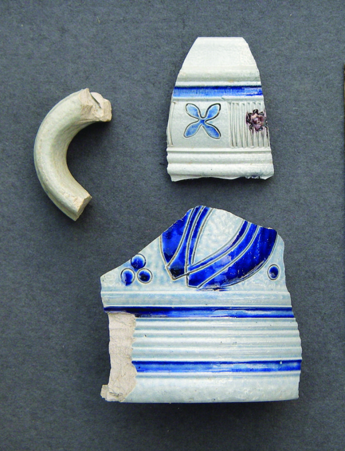 These fragments of German stoneware tankards were discovered in the stone-walled cellar. They date to the early-to-mid 1700s.Credit: Neill De Paoli .