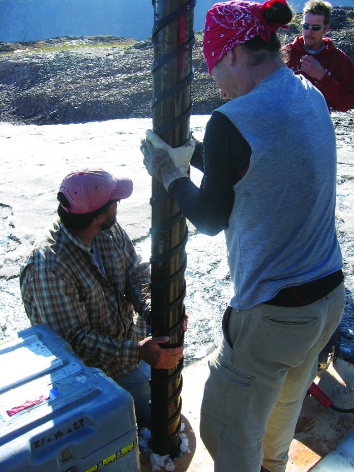 Craig Lee (left) and his colleagues Jay Kyne and Ben Woods start to drill an ice core. This is the only invasive technique the researchers employ. Photo INSTAAR/ Jennie Borresen Lee.