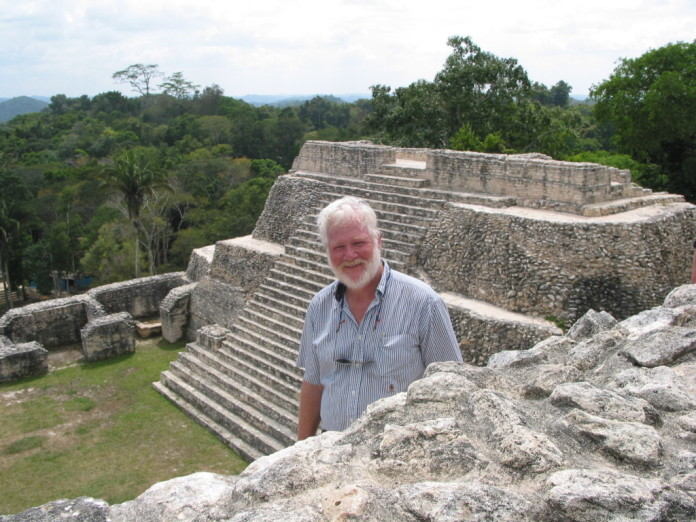 Henderson leading an Archaeological Conservancy Tour at Caana Pyramid a part of Caracol Mayan Ruins, Belize.