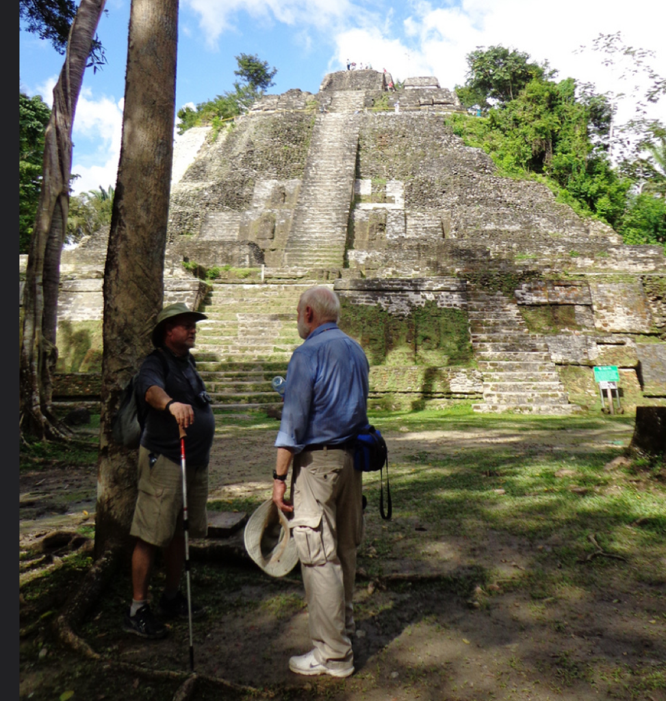 Professor Henderson Discussing with Tour participant at Lamanai, Belize. Photo Courtesy John Henderson.