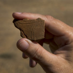A fragment of decorated pottery that was uncovered at the A.S. Mann site. Credit: Michael Amador, TXDOT