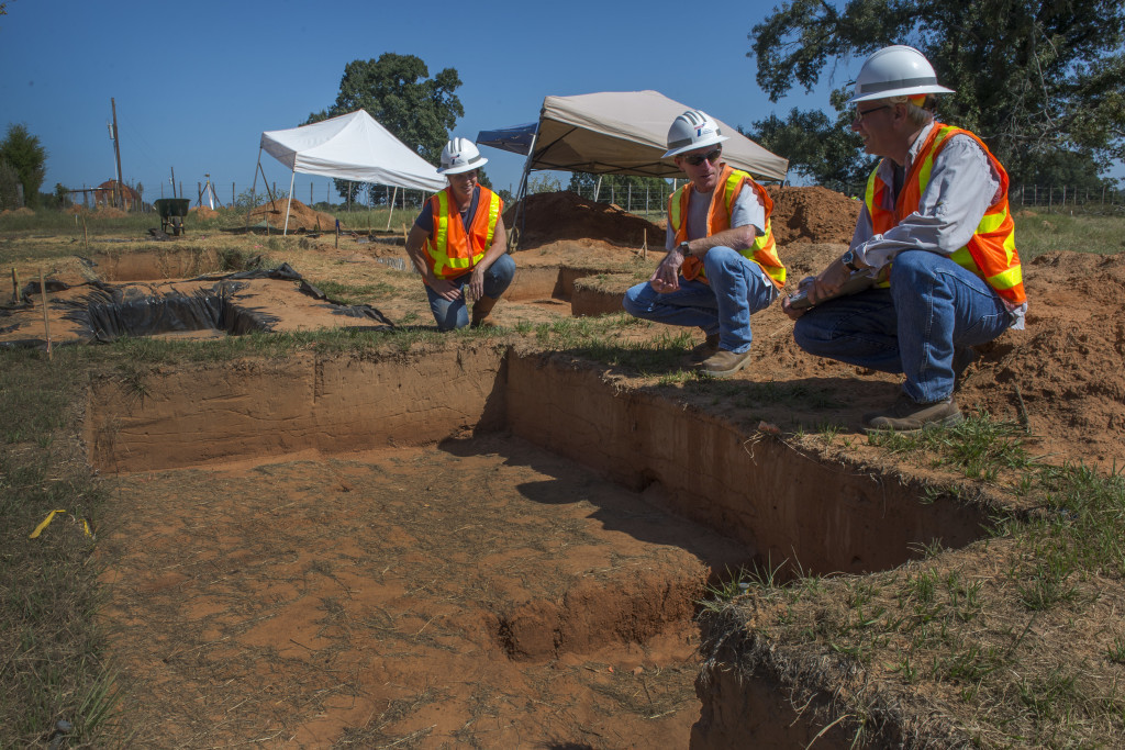TxDOT archaeologist Waldo Troell (right) examines an excavation unit with TxDOT environmental managers Christine Crosby (left) and Jay Tullos. Credit: Michael Amador, TXDOT