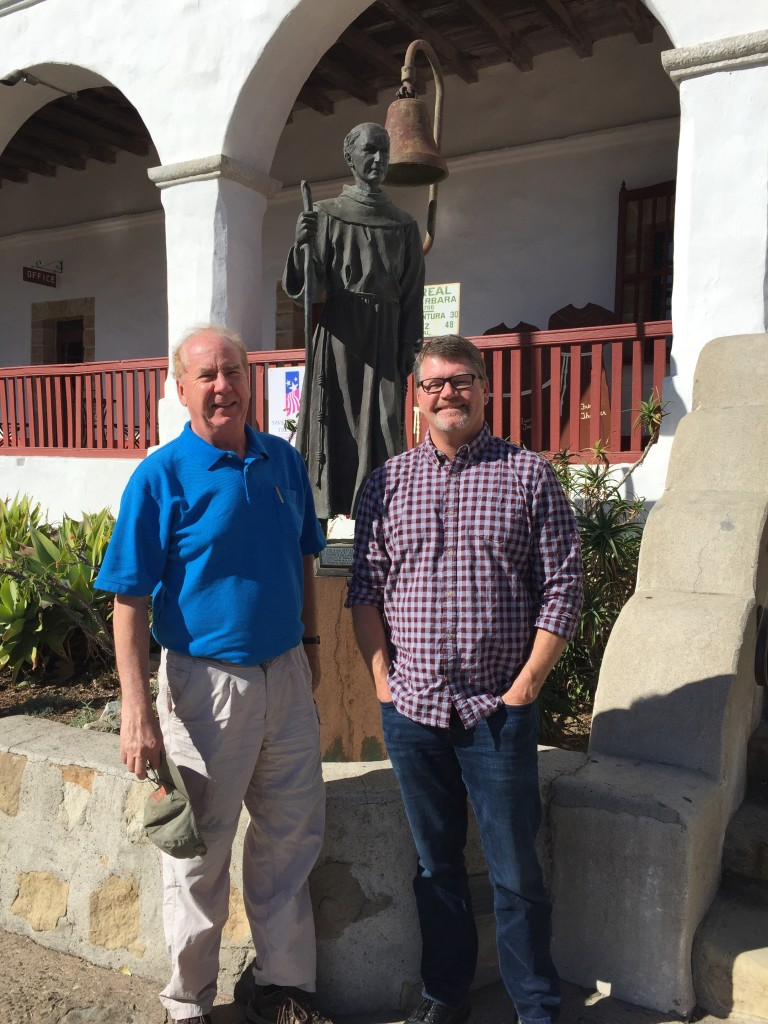 Photo 2: TAC President Mark Michel and TAC Western Regional Director Cory Wilkins posing with Father Junipero Serra, who founded the first nine missions in California