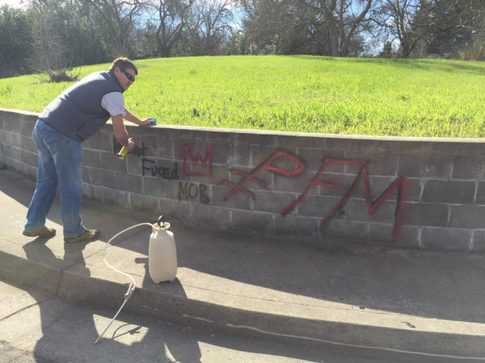 Cory Wilkins, Western Regional Director, working hard at removing the graffiti