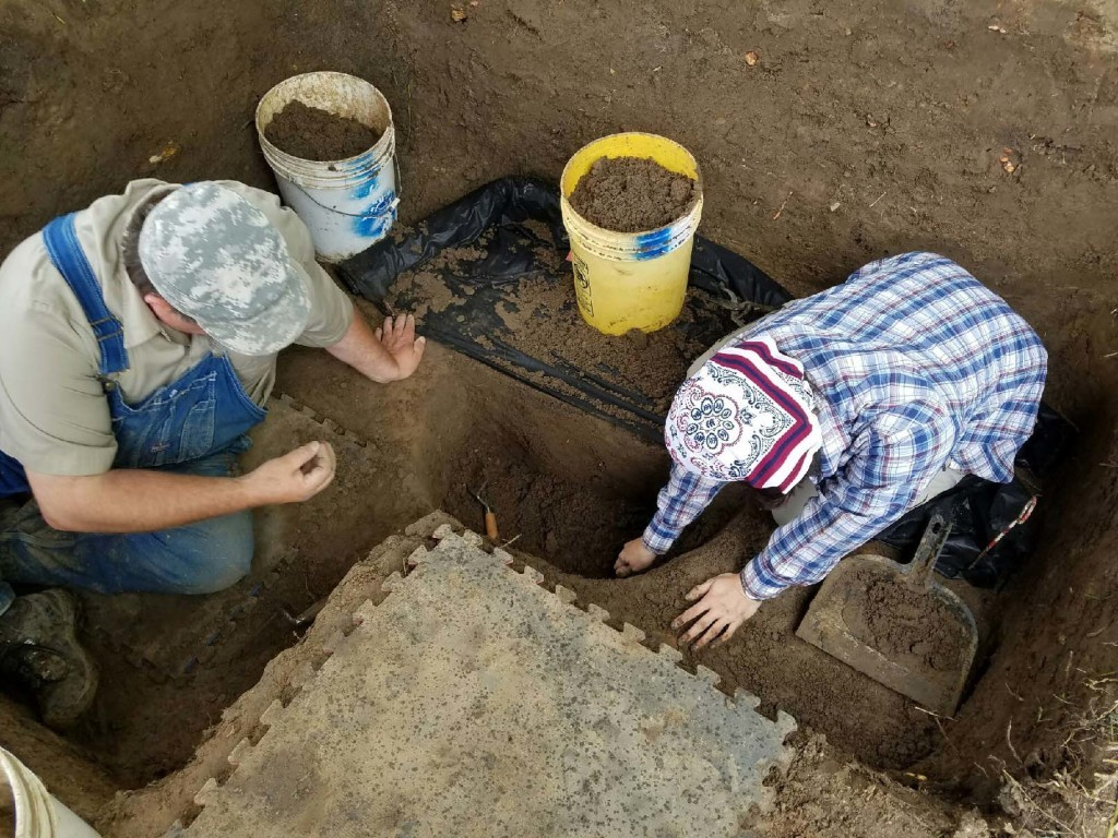 Jared Pebworth and Katie Leslie excavating a cross section of the post hole. Photo TAC/Jessica Crawford.