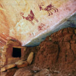 Pictographs of bighorn sheep adorn the ceiling of an alcove on Cedar Mesa. The area is known for its deep alcoves that shelter Ancestral Pueblo structures like these, likely dating to the 1200s. Credit: Alan Vandendriessche