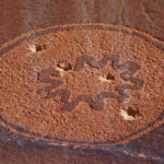 A 2000-year-old petroglyph was used for target shooting. Credit: Josh Ewing