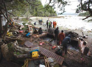 The crew excavates in an intertidal zone where the footprint features were found preserved beneath beach sands. Credit: Grant Callegari / Hakai Institute