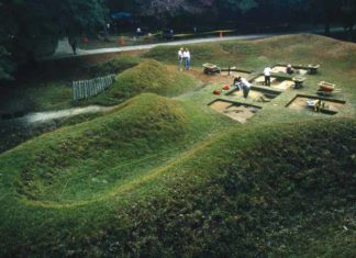 Archaeologists excavate around and within Fort Raleigh's reconstructed earthwork in 1990. CREDIT: Ira Block
