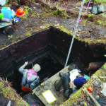 Archaeologists work in a deep excavation unit on Triquet Island, which is adjacent to Calvert. The work on Triquet was part of Duncan McLaren's investigation. Credit: Duncan McLaren