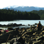 Wuikinuxv representative Johnny Johnson walks through a glacial boulder field on Calvert Island. Credit: Jenny Cohen