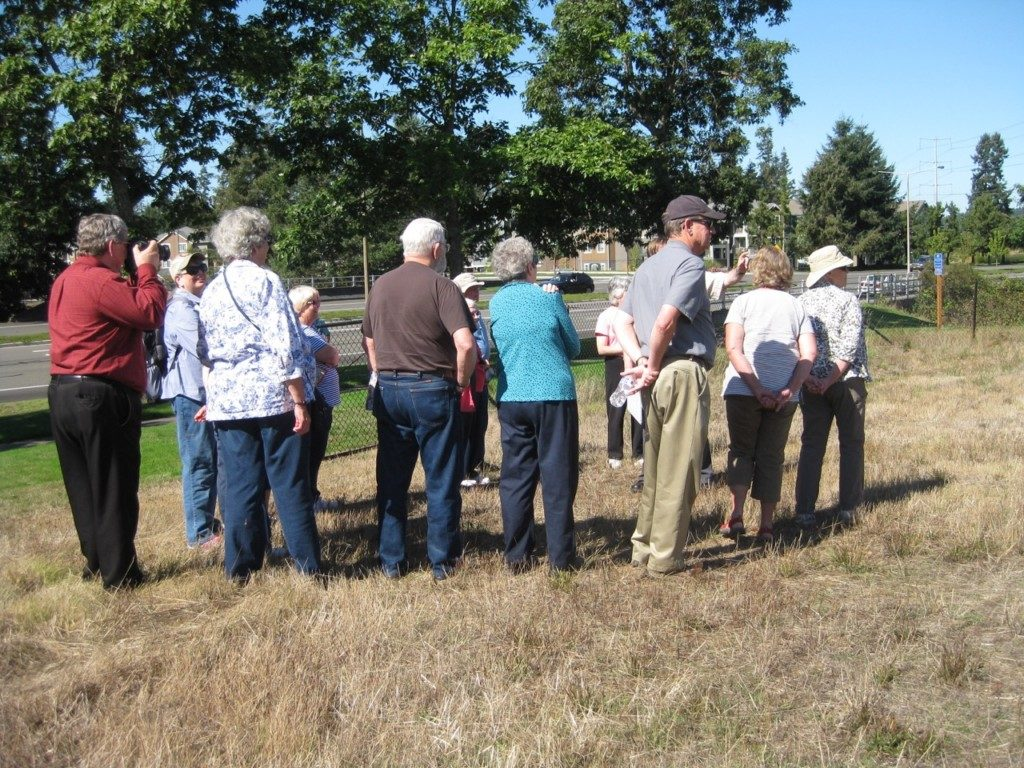Viewing the Site Today 1843 Fort Nisqually,  with scholar Drew Crooks. Photo  Carol Estep, DuPont Historical Society.