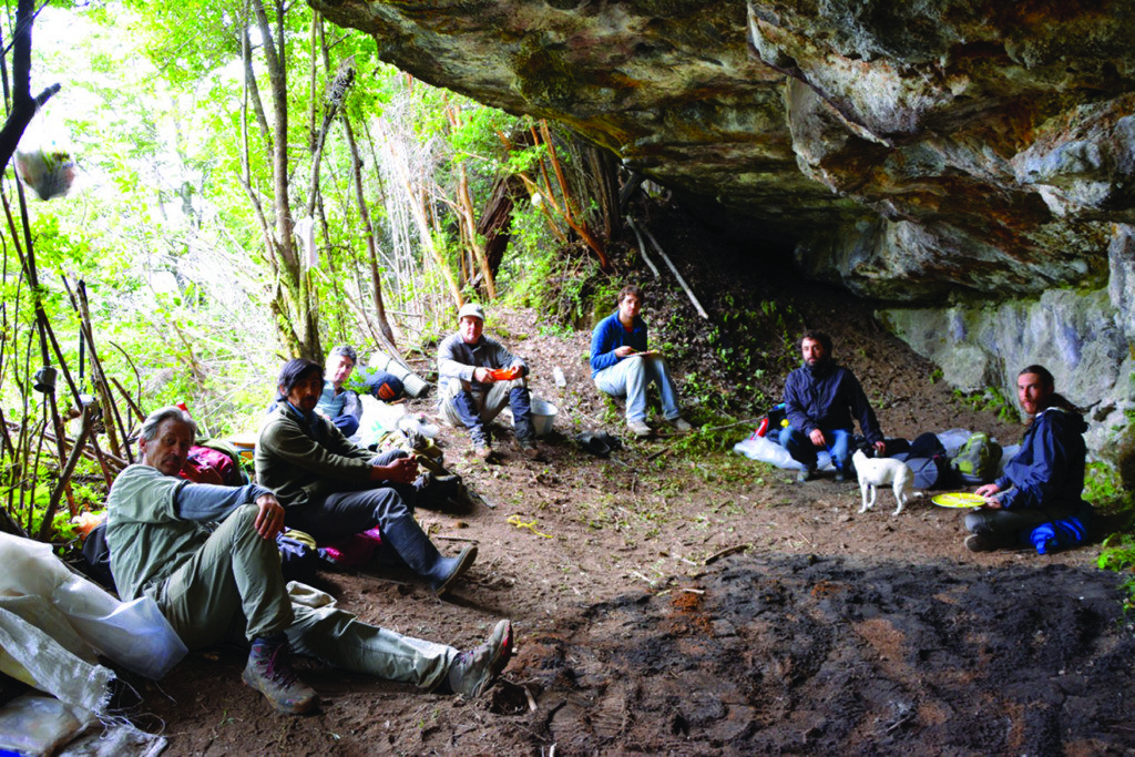 The crew takes a break during the 2016 excavation of a rock shelter near Monte Verde. Credit: Jorje Guzman
