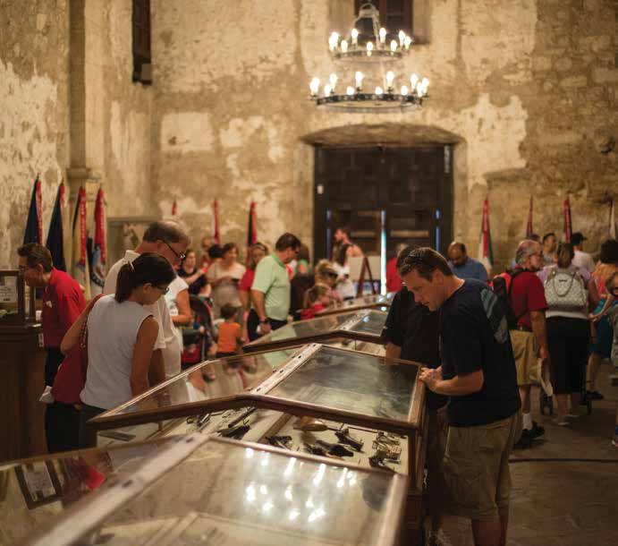 Tourists look at artifacts on display inside the Alamo. Photo Courtesy: Reimagine the Alamo
