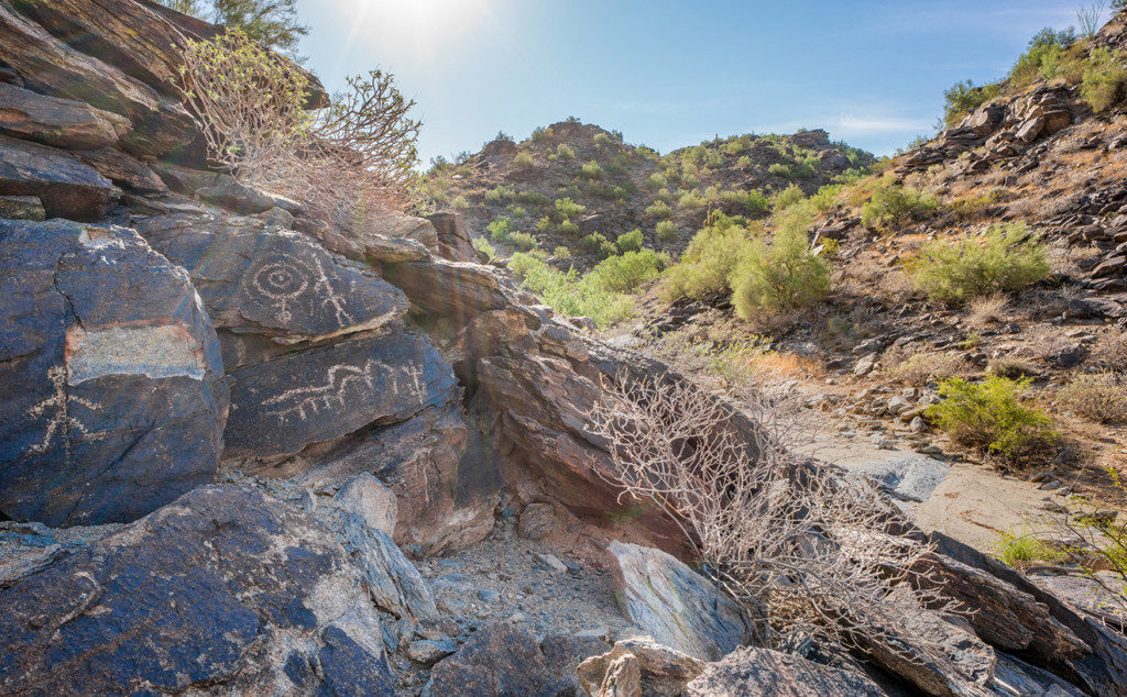 4. Many petroglyphs were strategically situated to be seen as people moved about the South Mountains. These glyphs were placed at eye-level at the mouth of a canyon, a place of heavy traffic. Credit: Paul Vanderveen