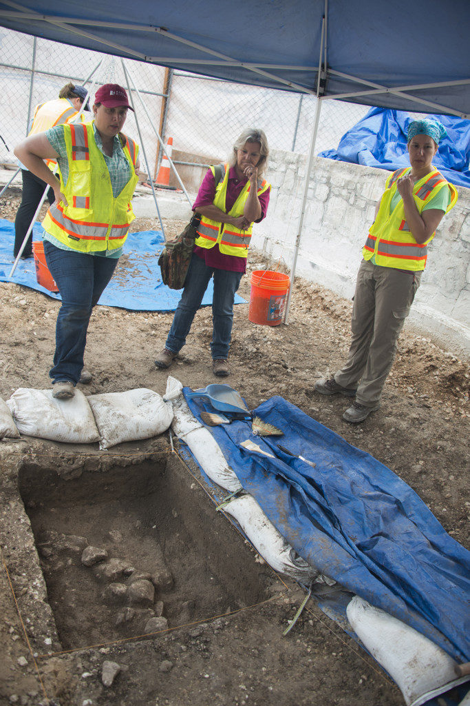 (From left to right) Archaeologists Kristi Nichols, Kay Hindes, and Nesta Anderson examine a trench. Credit: Reimagine The Alamo