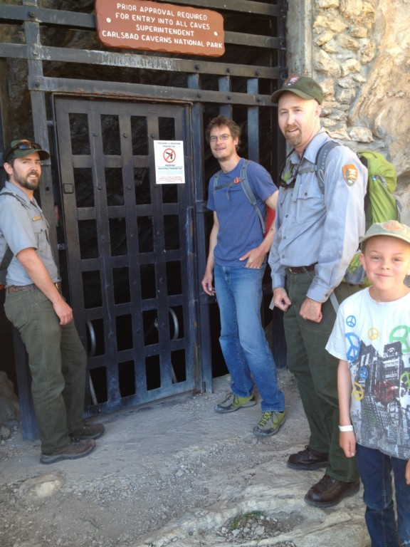 My son Leo about 6 years ago with an archaeologist and Rangers from Carlsbad Caverns showing us the entrance to Slaughter Cave, where I was doing a feature article.