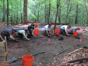 American University students remove a layer of soil from a large excavation block. The students subsequently exposed a community defense structure or building that dates to the early to mid 1800s. Credit: GDSLS/Sayers 2012