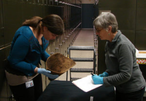 Archaeologists Erin Gearty and Laurie Webster document a prehistoric basket. Credit: American Museum Of Natural History, Cat. No. H/12264/ Laurie Webster