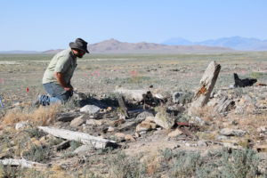 An archaeologist examines an outhouse feature in northwest Utah that was likely used by Chinese workers. Credit: Ken Cannon