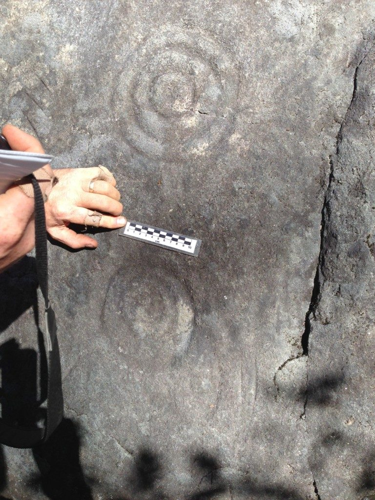 Documenting the many petroglyphs on the Terrarium Site. Photo The Archaeological Conservancy.