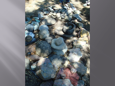 A density of Rock Cupules and other grinding Stones abound on Site.