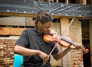 """After the welcome, guest were treated to musician William Ross, a student in Jackson State University's Classical Music Program, playing """"Amazing Grace."""" (Photo H.P. Lail Photography)"""