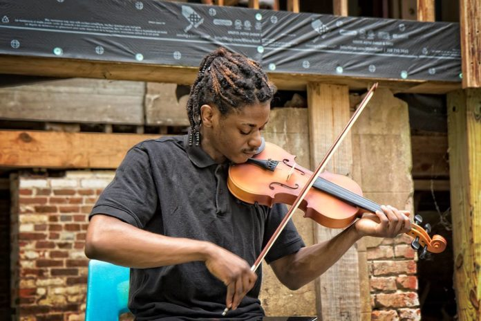 "After the welcome, guest were treated to musician William Ross, a student in Jackson State University's Classical Music Program, playing ""Amazing Grace."" (Photo H.P. Lail Photography)"