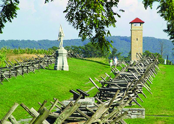 Visitors walk along Antietam National Battlefield's Bloody Lane, where 5,500 soldiers were killed or wounded in three hours' time. Credit: NPS .